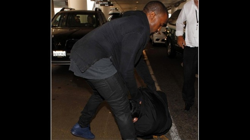 July 19, 2013: Kanye West Attacks Photographer At LAX