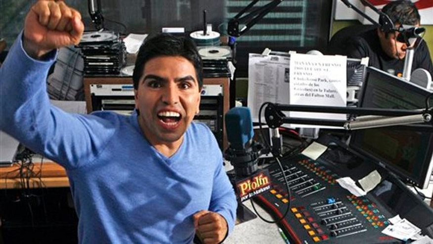 "FILE - In this Oct. 17, 2008 file photo, Mexican-American radio personality Eddie ""Piolin"" Sotelo records his show ""Piolin por la Manana"" at a radio studio in Glendale, Calif."