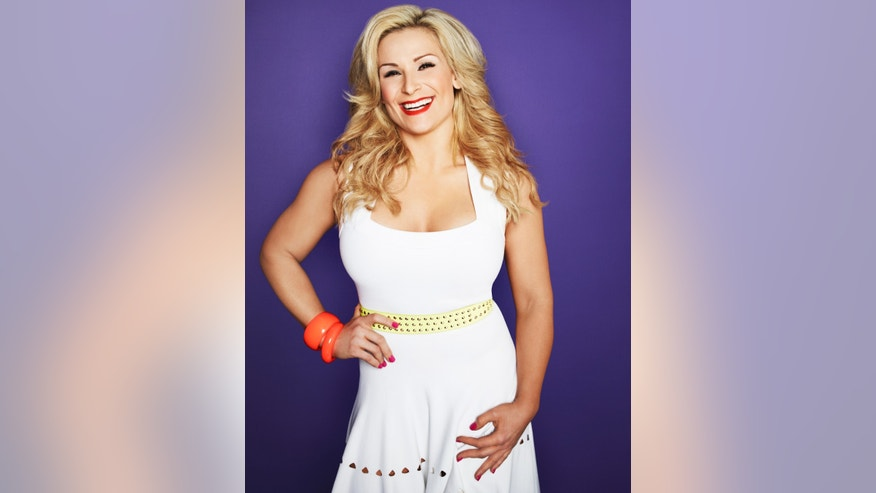 "WWE wrestler Natalya poses in a promotional photo for E!'s ""Total Divas."""