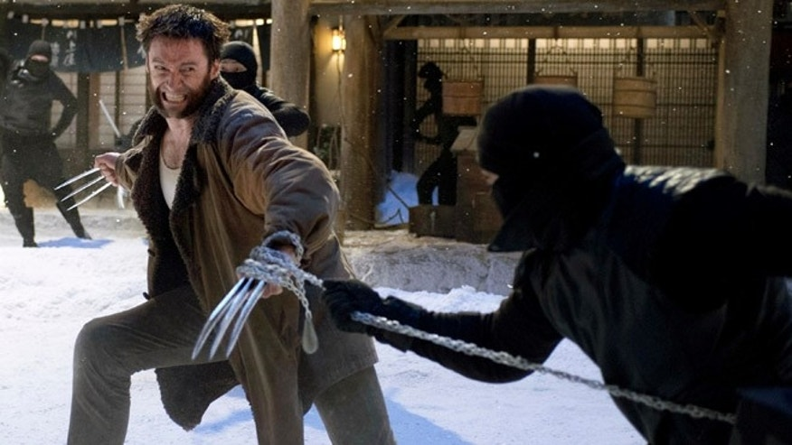 "This publicity image released by 20th Century Fox shows Hugh Jackman in a scene from ""The Wolverine."""