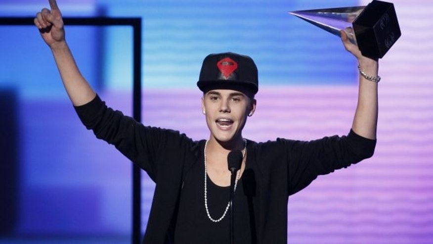 """Nov. 18, 2012: Justin Bieber accepts the award for favorite pop rock album for """"Believe"""" at the 40th American Music Awards in Los Angeles, California."""