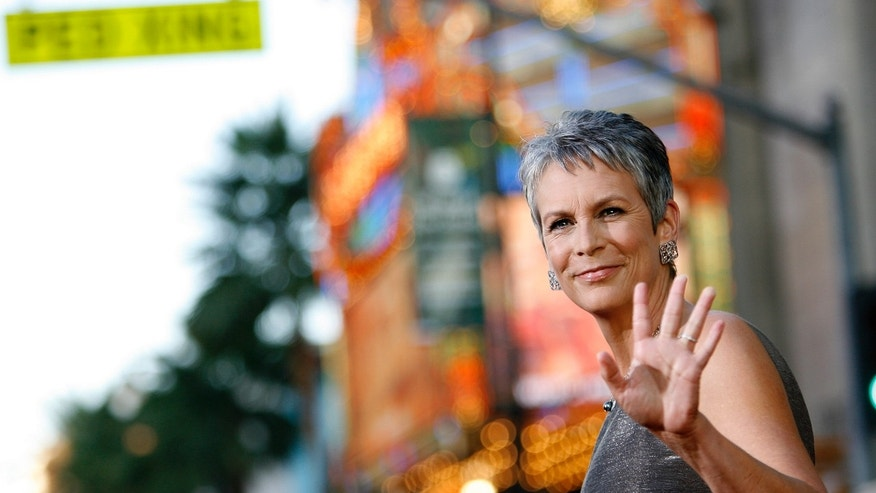 "Cast member Jamie Lee Curtis waves at the world premiere of ""Beverly Hills Chihuahua"" at El Capitan theatre in Hollywood, California September 18, 2008."