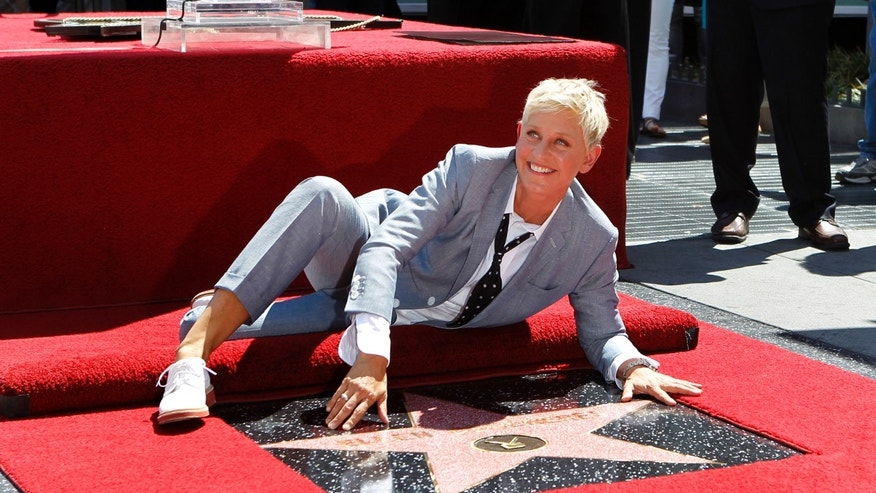 Television personality Ellen DeGeneres touches her star after it was unveiled on the Walk of Fame in Hollywood, California September 4, 2012.