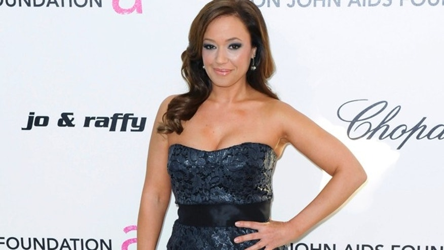 Actress Leah Remini poses as she arrives at the 19th Annual Elton John AIDS Foundation Academy Award Viewing Party in West Hollywood, California February 27, 2011.
