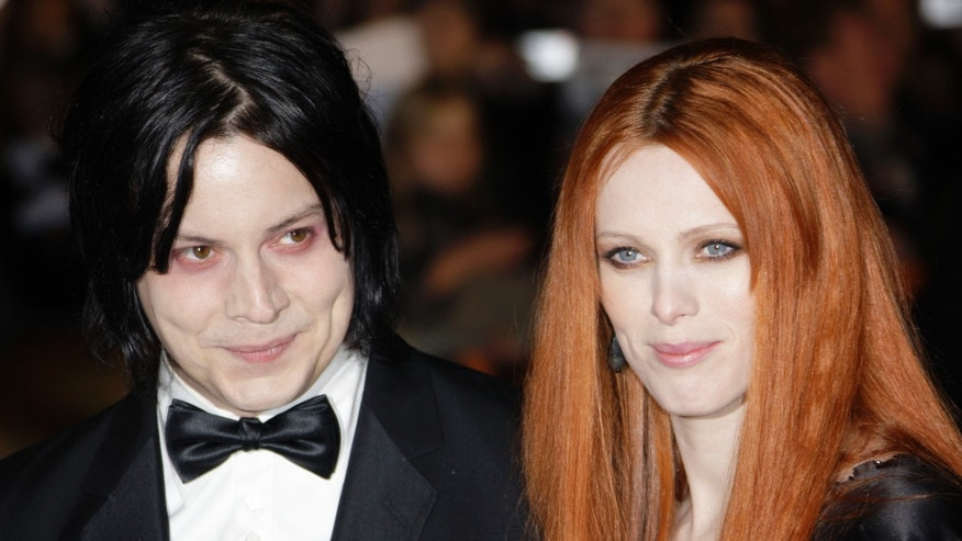 "In this Oct. 29, 2008 file photo, musician Jack White, left, and Karen Elson arrive on the red carpet for the Royal World Premiere of the 22nd James Bond film, ""Quantum of Solace"" in London."