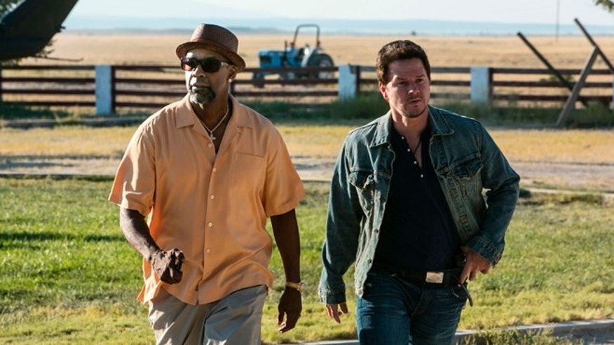 "This image released by Universal Pictures shows Denzel Washington, left, and Mark Wahlberg in a scene from ""2 Guns."""