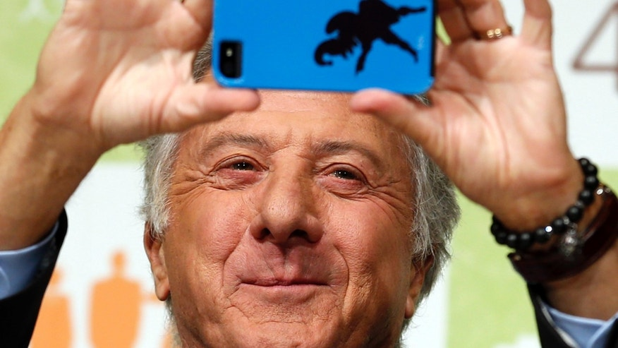 "April 9, 2013: Actor Dustin Hoffman takes a photograph during a press conference to promote his film ""Quartet"" in Tokyo."