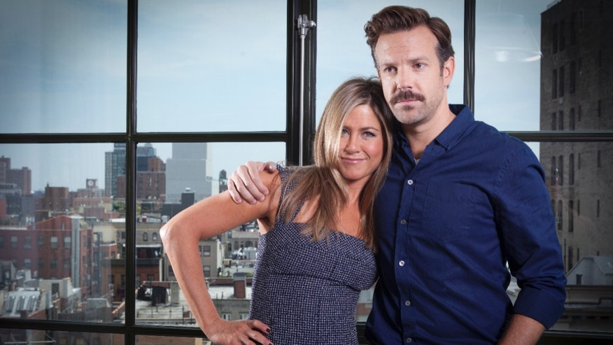 "FILE - In this July 27, 2013 file photo, actor Jason Sudeikis, right, and actress Jennifer Aniston pose for a portrait as they promote the movie ""We're the Millers"" in New York. The film opens nationwide on Wednesday, Aug. 7. (Photo by Carlo Allegri/Invision/AP, File)"