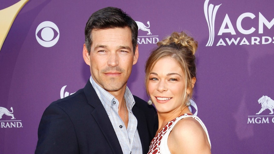 This April 1, 2012 file photo shows country singer LeAnn Rimes, right, and her husband Eddie Cibrian at the 47th Annual Academy of Country Music Awards in Las Vegas.