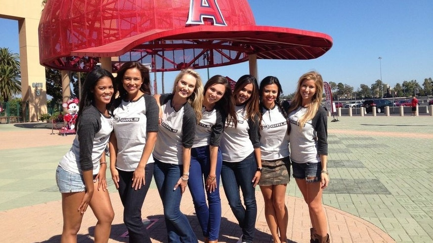 Women are seen promoting Fox Sports 1, America's new national sports network.