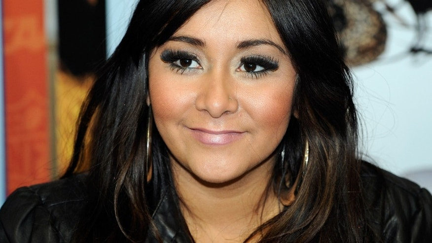 "LAS VEGAS, NV - FEBRUARY 15:  Television personality Nicole ""Snooki"" Polizzi promotes her Snooki Slippers line licensed by Happy Feet at the MAGIC clothing industry convention at the Las Vegas Convention Center February 15, 2011 in Las Vegas, Nevada.  (Photo by Ethan Miller/Getty Images)"