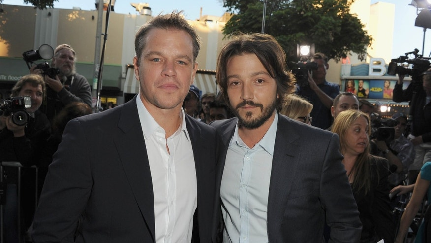 "Actors Matt Damon and Diego Luna attend the premiere of TriStar Pictures' ""Elysium""  at Regency Village Theatre on August 7, 2013 in Westwood, California."