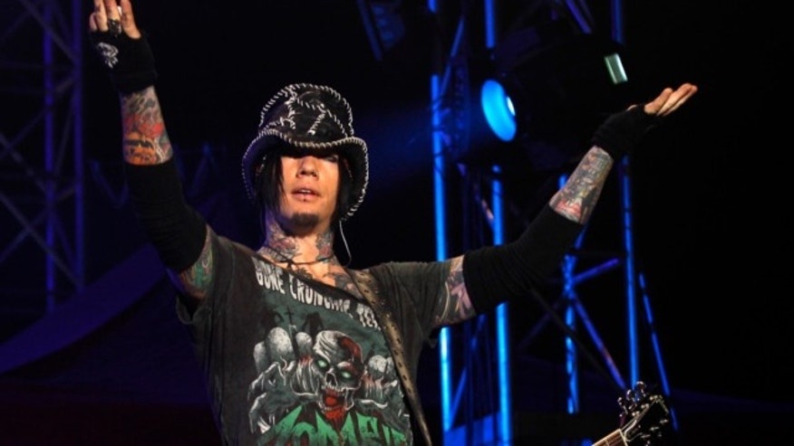 Dec. 7,2012: Guns N' Roses guitarist DJ Ashba reacts to the crowd as he performs during a concert in Bangalore, India. Las Vegas police are investigating whether employees went too far after reportedly helping Ashba with an elaborate proposal.