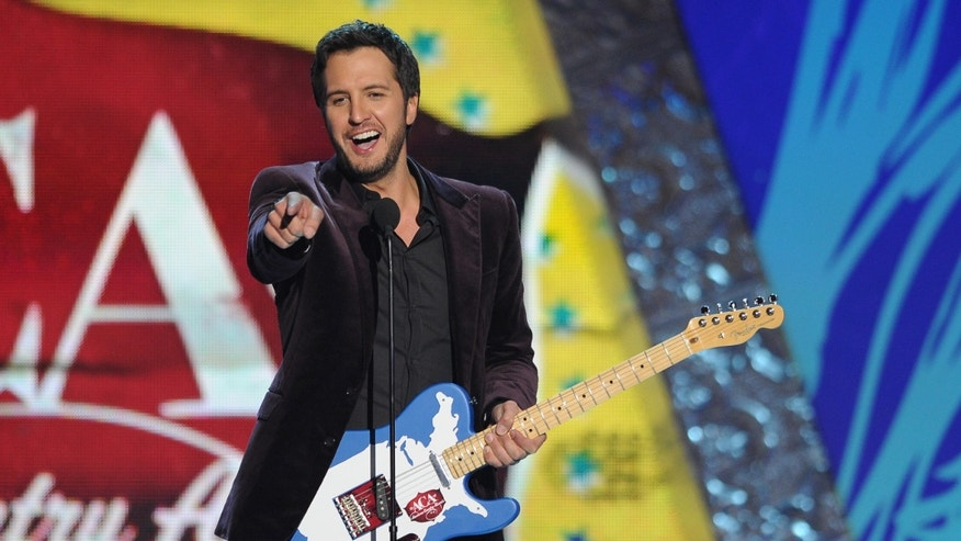 Luke Bryan accepts the award for 'Artist of the Year' during the American Country Awards on Dec. 10, 2012.