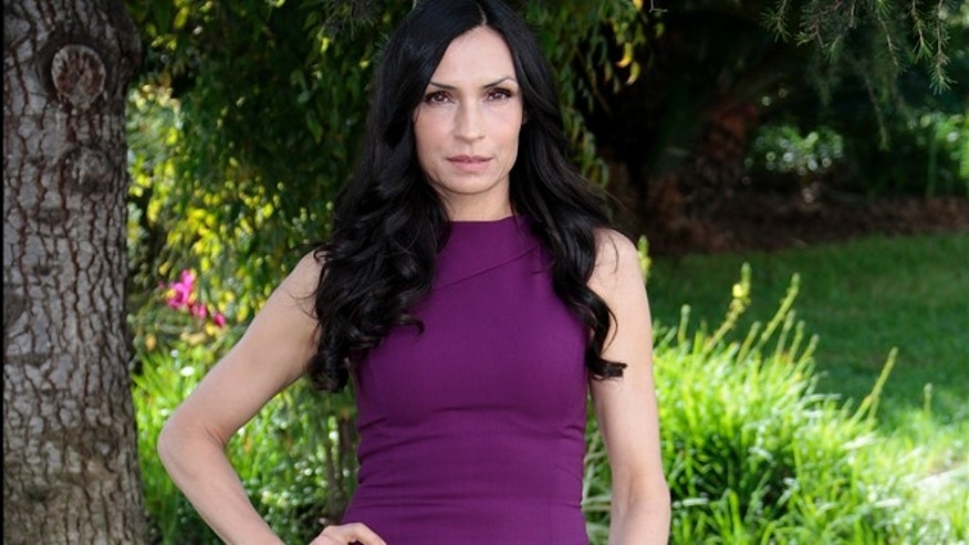 Dutch actress Famke Janssen attends a photocall for the television series 'Hemlock Grove' as part of the MIPTV, the International Television Programs Market, event in Cannes April 9, 2013.