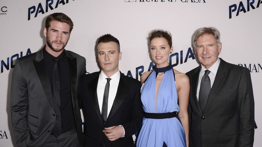 "From left to right, actor Liam Hemsworth, director Robert Luketic, actress Amber Heard, and actor Harrison Ford arrive on the red carpet at the US premiere of the feature film ""Paranoia"" at the DGA Theatre on Thursday, Aug. 8, 2013 in Los Angeles."