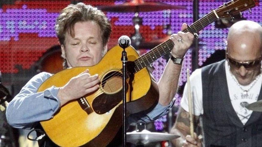 "Singer John Mellencamp performs ""Down By The River"" at the 2010 MusiCares Person of the Year tribute honoring recording artist Neil Young in Los Angeles January 29, 2010. (Reuters)"