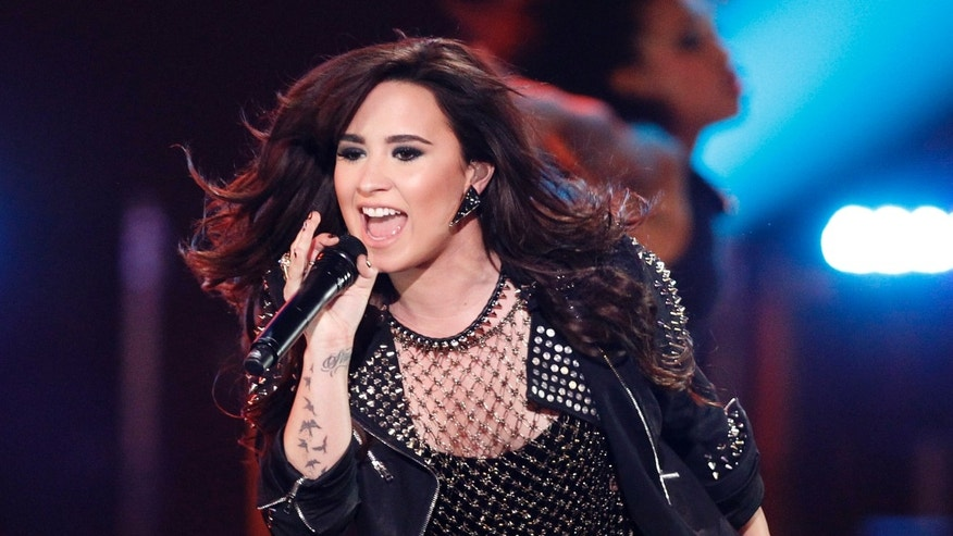 "Recording artist Demi Lovato performs ""Give Your Heart a Break"" during the VH1 Divas 2012 show in Los Angeles, December 16, 2012."