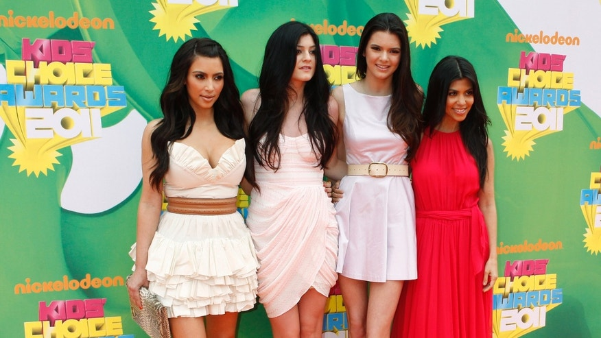 Family members Kim Kardashian, Kylie Jenner, Kendall Jenner and Kourtney Kardashian pose at the 2011 Nickelodeon Kids Choice Awards in Los Angeles, California April 2, 2011.
