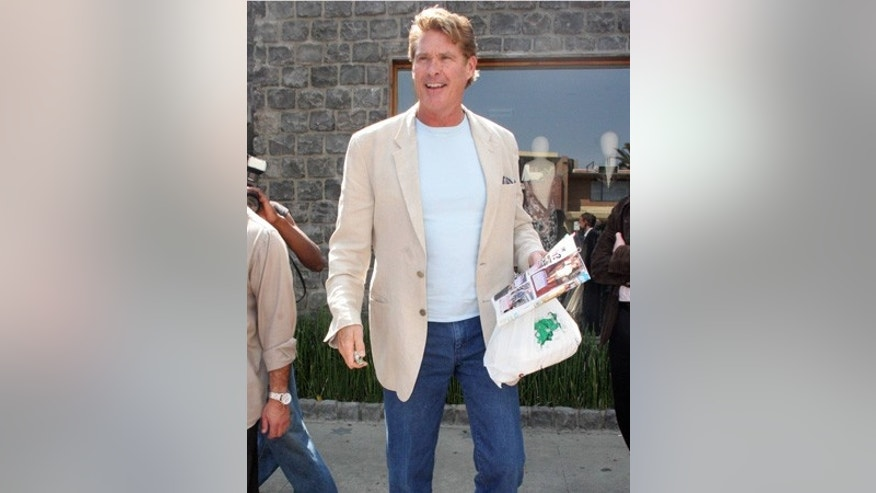 David Hasselhoff drives his mini Cooper and reads Life and Style magazine as he is leaving the Ivy in Beverly Hills
