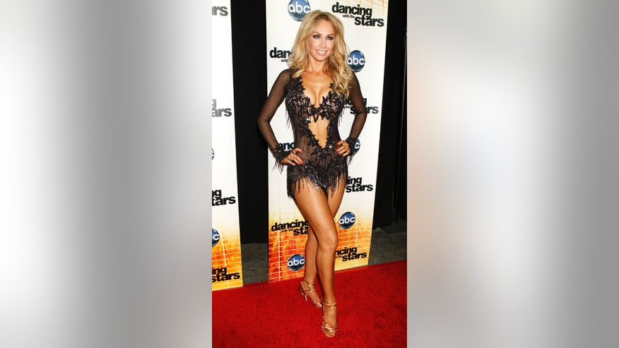 "Professional dancer Kym Johnson poses backstage after the premiere of ABC's series ""Dancing with the Stars Season 11"" in Los Angeles September 20, 2010."