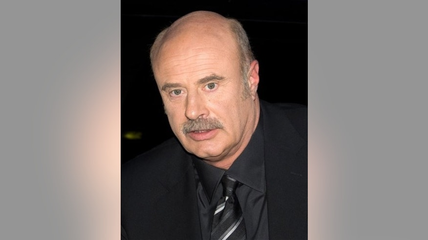 "FILE - In this March 4, 2009 file photo, Dr. Phil McGraw arrives for a taping of ""The Late Show with David Letterman"" in New York. (AP Photo/Charles Sykes, file)"