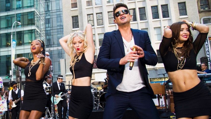 "FILE - This July 30, 2013 file photo shows Robin Thicke performing on NBC's ""Today"" show in New York. An attorney for Thicke and collaborator Pharrell Williams filed a lawsuit Thursday, Aug. 16, 2013, in Los Angeles, asking a federal judge to determine that the pairs hit song Blurred Lines does not copy elements from two older songs by Marvin Gaye and George Clinton. (Photo by Charles Sykes/Invision/AP, File)"