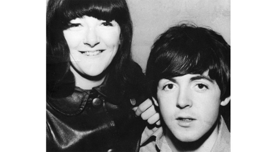 Freda Kelly is seen posing with Paul McCartney.
