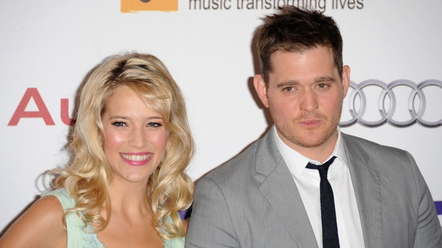 Luisana Lopilato and singer Michael Buble attend the Nordoff Robbins O2 Silver Clef Awards on June 29, 2012 in London, England.