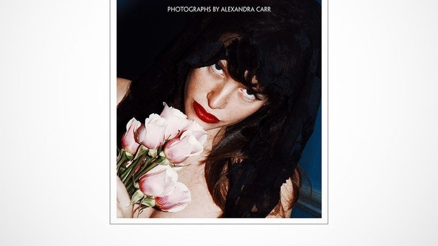"Paz de la Huerta appears on the cover of ""The Birds Didn't Die Over the Winter."""