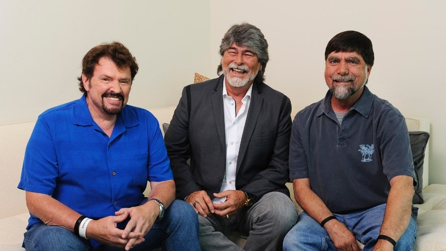 "In this Tuesday, Aug. 13, 2013 photo, Jeff Cook, Randy Owen and Teddy Gentry from the American country music band Alabama pose for a portrait in Nashville, Tenn. Alabama has launched a tour and released a new album this week, ""Alabama & Friends,"" that features duets of the group's biggest hits with top country stars."