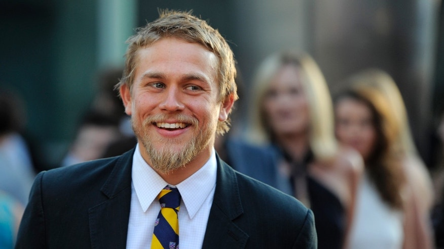 "FILE - In a Tuesday, Aug. 30, 2011 file photo, Charlie Hunnam, a cast member in ""Sons of Anarchy,"" arrives at a screening of the fourth season premiere of the television series, in Los Angeles.  Focus Features and Universal Pictures announced Monday, Sept. 2, 2013 that Hunnam will play the 27-year-old billionaire Christian Grey in the  big-screen adaptation of E L James Fifty Shades of Grey. Dakota Johnson will play the college student he captivates, Anastasia Steele. (AP Photo/Chris Pizzello, File)"