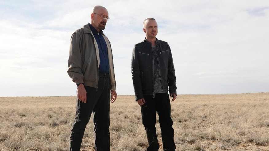 "FILE - This file image released by AMC shows Bryan Cranston as Walter White, left, and Aaron Paul as Jesse Pinkman in a scene from the season 5 premiere of  ""Breaking Bad."""