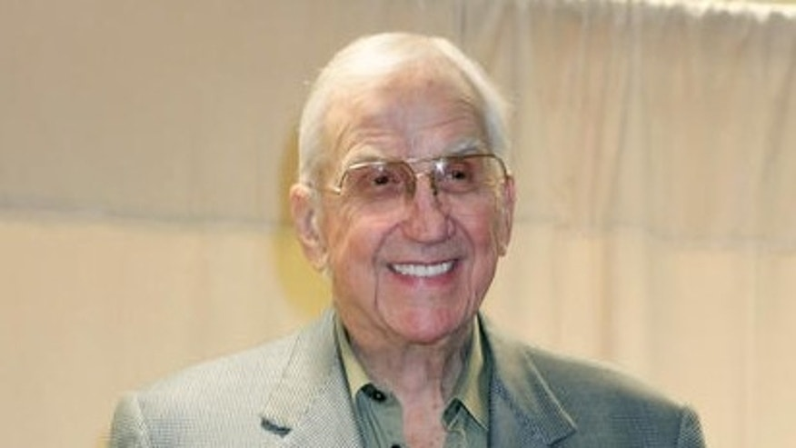 "Ed McMahon poses with a copy of his new book ""Here's Johnny!,"" a collection of his memories of ""Tonight Show"" host Johnny Carson,  Tuesday, Oct. 18, 2005, at a Barnes & Noble bookstore in New York. (AP Photo/Diane Bondareff)"
