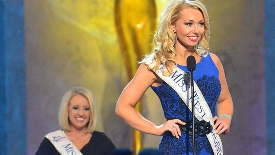 Miss West Virginia, Miranda Harrison, speaks during the preliminary competition of the Miss America Pageant at Boardwalk Hall on Tuesday Sept. 10, 2013, in Atlantic City, N.J. The preliminary competitions began Tuesday, which is back in Atlantic City after a six-year absence.