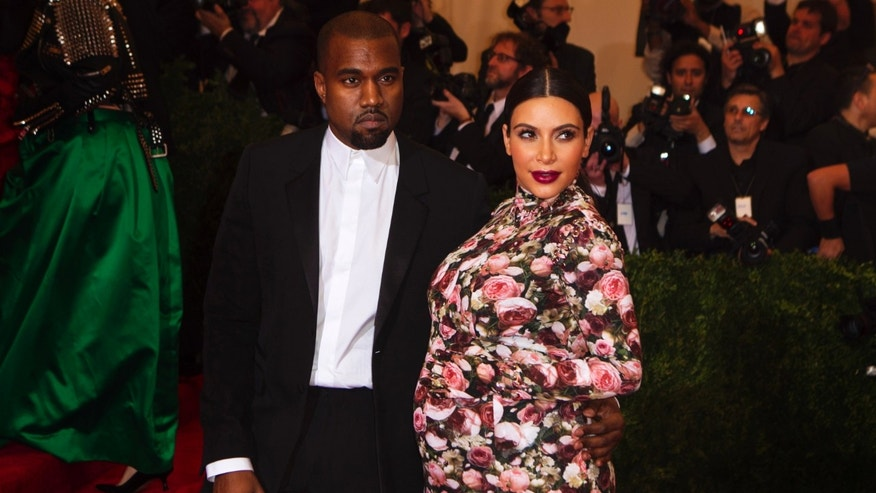 "Singer Kanye West and reality television actress Kim Kardashian arrive at the Metropolitan Museum of Art Costume Institute Benefit celebrating the opening of ""PUNK: Chaos to Couture"" in New York, May 6, 2013."