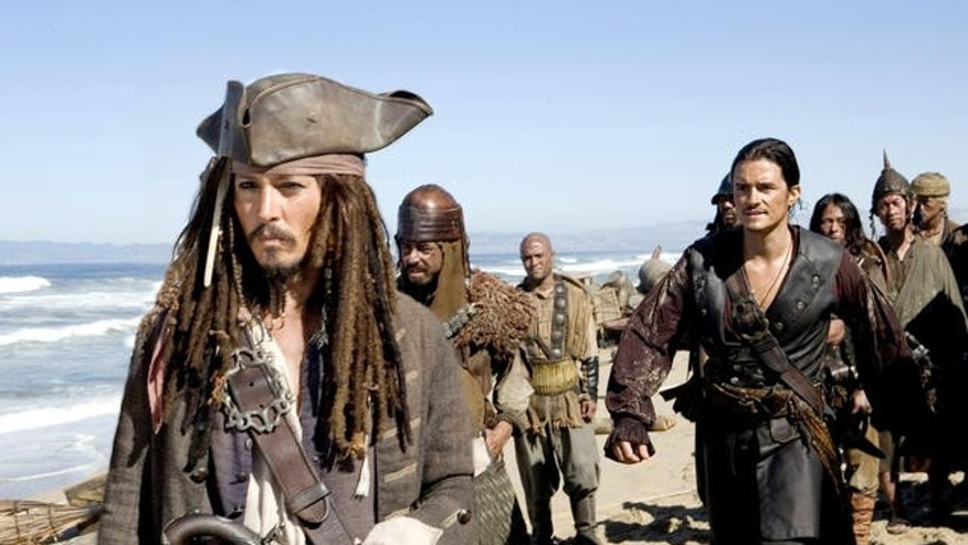 "This undated photo released by Disney Enterprises shows actors Johnny Depp, left, as Jack Sparrow and Orlando Bloom in a scene from ""Pirates of Caribbean: At Worlds End.""   Pirate films are almost as old as movies themselves.  Depp defines the pirate of the new millennium with his drunken, dreadlocked scamp at the center of Disney's ""Pirates of the Caribbean"" trilogy. With his flamboyant style and campy charm, Depp's Jack Sparrow is a departure from the macho swashbucklers of yore, yet with the same good looks and rebellious edge that have long made pirate films so popular. (AP Photo/Disney Enterprises, Stephen Vaughan)"