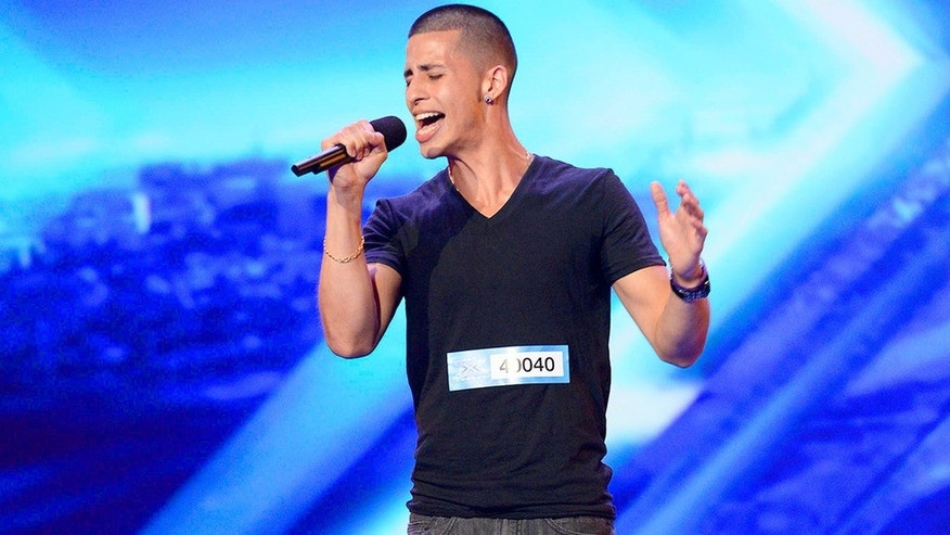"Carlito Olivero, 23, of Chicago sings during the season three premiere of Fox's ""X Factor."""