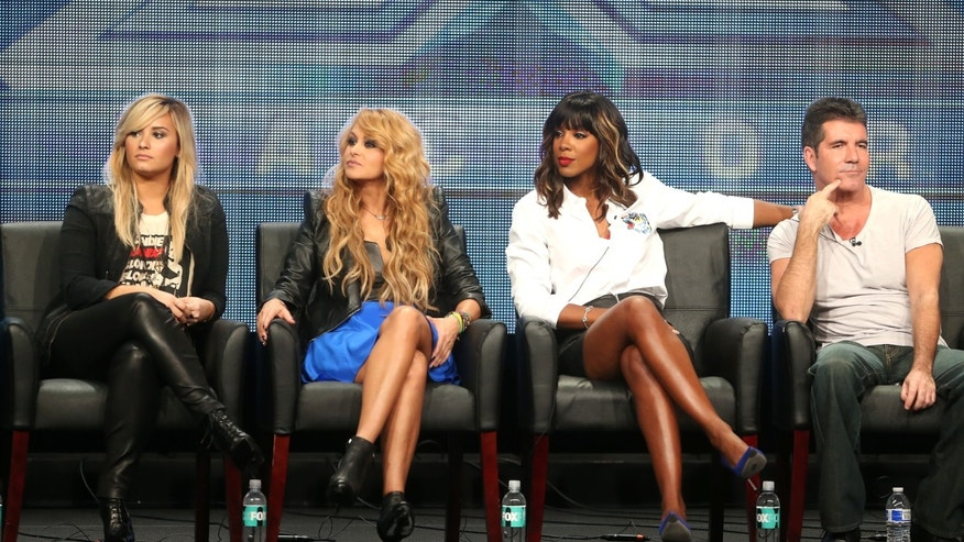 Judges Demi Lovato, Paulina Rubio, Kelly Rowland, and Simon Cowell during the The X Factor panel discussion at The Beverly Hilton Hotel  on August 1, 2013 in Beverly Hills, California.