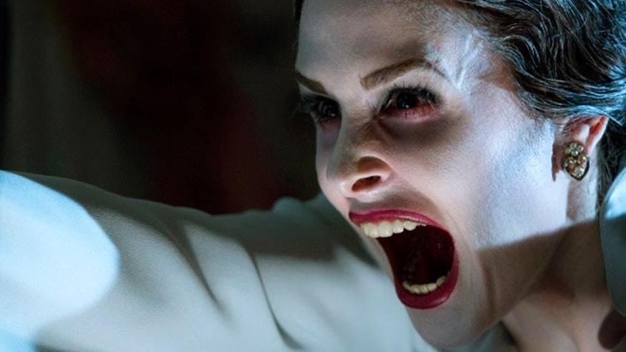 "This film image released by FilmDistrict shows Danielle Bisutti in a scene from ""Insidious: Chapter 2."""