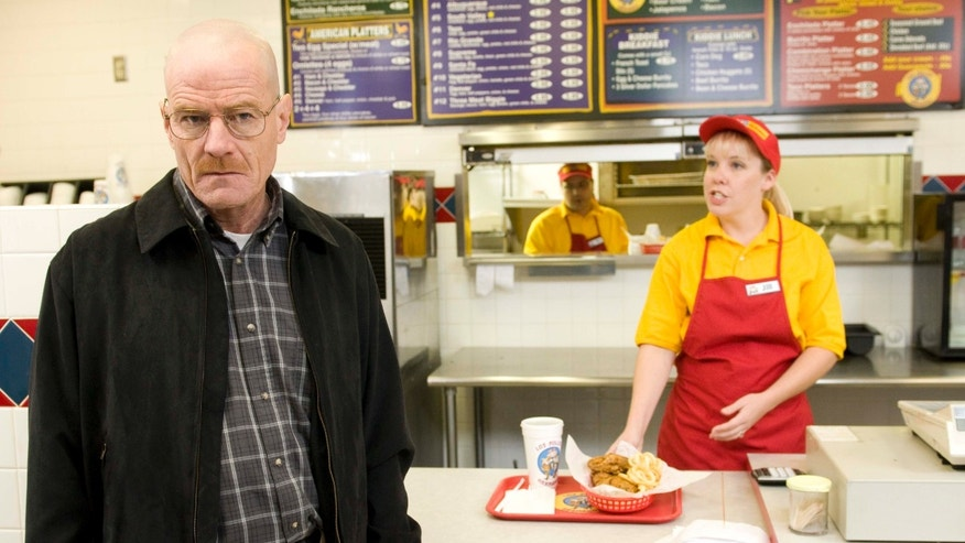 "This image released by AMC shows Bryan Cranston as Walter White at the fictional restaurant ""Los Pollos Hermanos"" in a scene from season 2 of the AMC series ""Breaking Bad."""