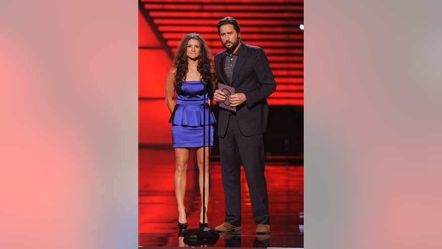 Race car driver Danica Patrick and actor Luke Wilson present the best team award at the ESPY Awards on Wednesday, July 14, 2010 in Los Angeles. (AP Photos/Chris Pizzello)
