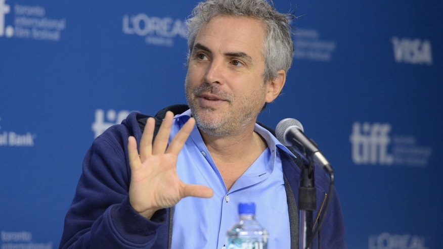 "TORONTO, ON - SEPTEMBER 09:  Director Alfonso Cuaron speaks onstage at ""Gravity"" Press Conference during the 2013 Toronto International Film Festival at TIFF Bell Lightbox on September 9, 2013 in Toronto, Canada.  (Photo by Jason Merritt/Getty Images)"