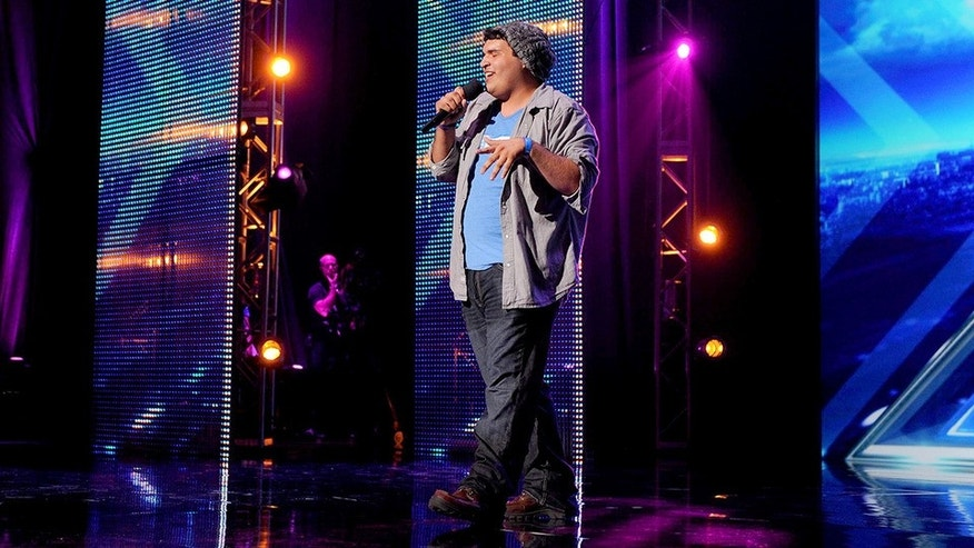 "Carlos Guevara, 16, of South Carolina sings ""Gravity"" by John Mayer during ""X Factor"" on Wednesday Sept. 18."