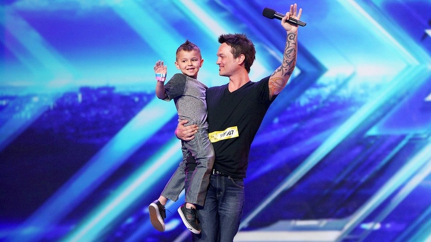 "Rocker Jeff Gutt and his son following his redeeming ""X Factor"" audition."