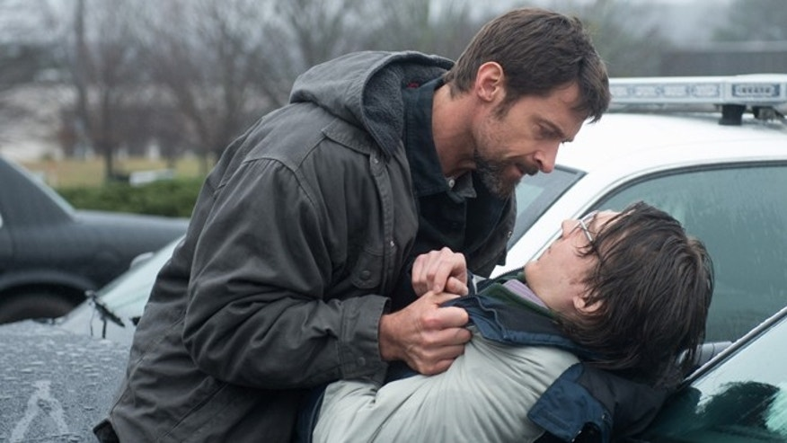 "This image released by Warner Bros. Pictures shows Hugh Jackman, left, and Paul Dano in a scene from ""Prisoners."""