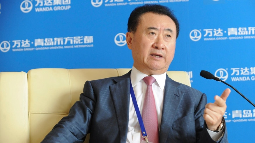 Wanda Chairman Wang Jianlin speaks during a press conference after a launching ceremony of Qingdao Oriental Movie Metropolis in Qingdao in east China's Shandong province, Sunday, Sept. 22, 2013.