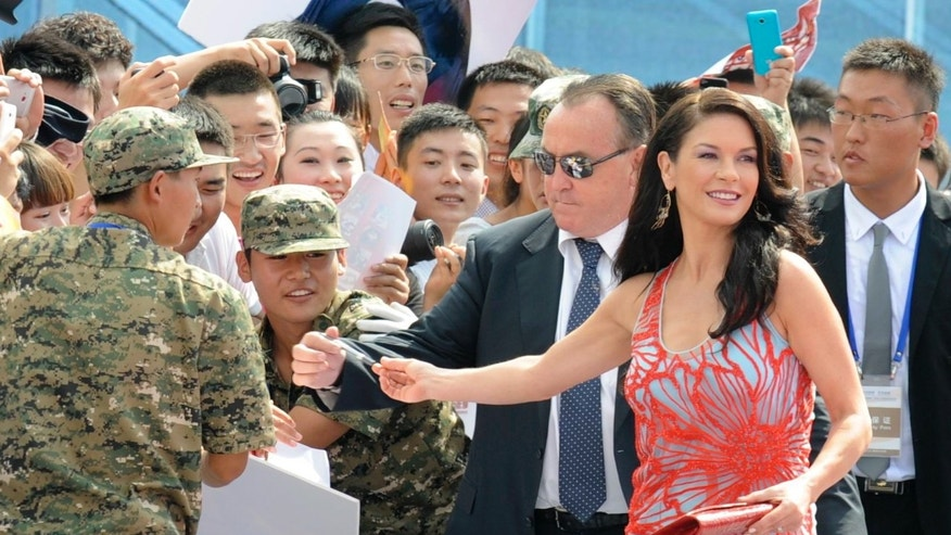 Catherine Zeta Jones walks on a red carpet in an event to celebrate the launching of Qingdao Oriental Movie Metropolis in Qingdao, in east China's Shandong province, Sunday, Sept. 22, 2013.