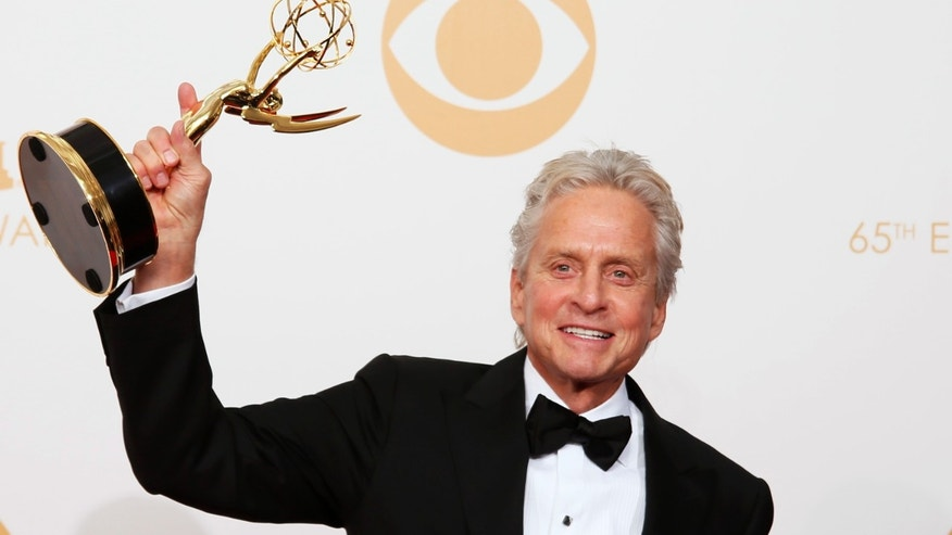 "Actor Michael Douglas from HBO's movie ""Behind the Candelabra"" poses backstage with his award for Outstanding Lead Actor In A Miniseries Or A Movie at the 65th Primetime Emmy Awards in Los Angeles September 22, 2013."