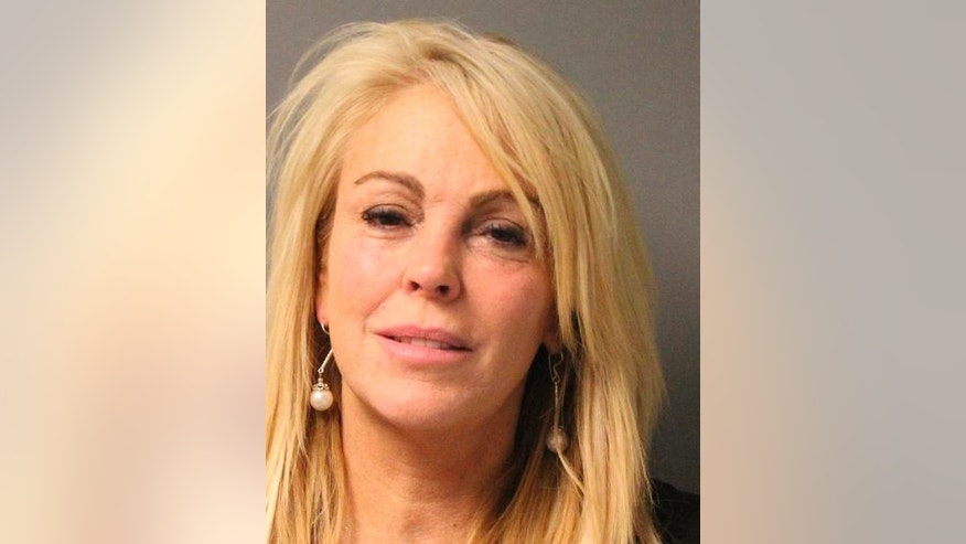 Dina Lohan is pictured in this undated booking photo courtesy of the New York State Police. Lohan, the mother of troubled actress Lindsay Lohan, was arrested and charged with drunken driving on the night of September 12, 2013, after she was stopped for speeding in New York, police said.